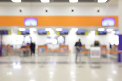 Check-in counters. In airport out of focus - bokeh background stock photography