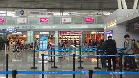 Check-in counters in Changsha International Airport. Asian travellers waiting at check-in counters in Changsha International Airport. Changsha Airport is the stock video footage