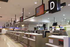 Check-in counters in Melbourne Airport. Melbourne, Australia - May 8, 2015: Check-in counters in International Departures level in Melbourne Airport, Melbourne royalty free stock images