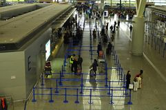 Check In Counters in Terminal Two of Pudong International Airport Shanghai. An aerial view of people queuing in the check in counters area of Pudong Stock Photo