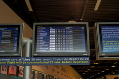 Check-In, Departure and Arrival information board in Airport. Paris, France - September 22, 2015: Check-In, Departure & Arrival information board at Charles de Stock Photography
