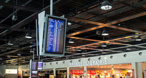 Check-In, Departure and Arrival information board in airport. Paris, France - September 22, 2015: Check-In, Departure & Arrival information board at Charles de Stock Image