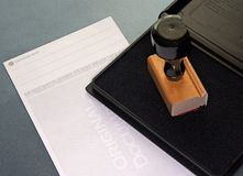 Check and endorsement pad. Check and endorsement stamp and ink pad Royalty Free Stock Photo