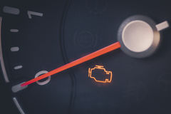 Check engine icon. Close up shot of a check engine icon in a car Stock Photography