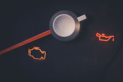 Check engine icon. Close up shot of a check engine and oil icons in a car Stock Photo