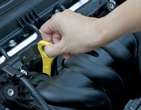 Check Engine Oil. Woman hand check the engine oil . Concept of maintaining car engine Royalty Free Stock Photo