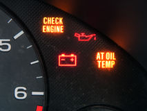 Check engine and other warning signage on car dashboard Stock Photo