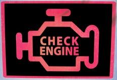 Check Engine signage. Check Engine warning signage on car dashboard Stock Photos