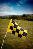 Check Flag Golf Range. Yellow & Black check flag at a Golf Driving Range, Hill with blue sky Stock Photos
