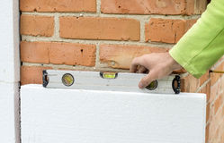 Check flatness of the wall using a level Royalty Free Stock Photos