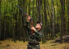 Check a gun. Stock Photo