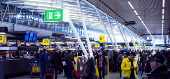 Check-in hall at Schiphol airport Stock Photos