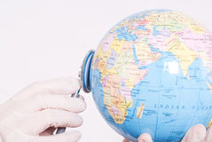 Check health status. Checking the health of the entire world with stethoscope Royalty Free Stock Photo