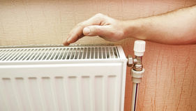 Check of heating of a radiator Stock Photos