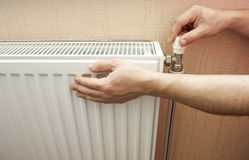 Check of heating of a radiator Royalty Free Stock Photography