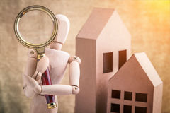 Check a house concept wooden person with a magnifying glass Stock Photos