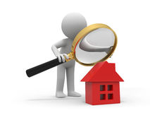 Check a house. A person with a magnifying glass to check a house Stock Image