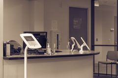 Check-in kiosk tablet at front desk of diagnostic testing. Check-in kiosk tablet upon arrival at front desk of test center for diagnostic testing, medical stock photos