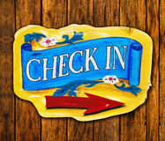 Check in letter wood board on wood background Royalty Free Stock Photo