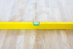 Check liquid vial indicator or horizontal marker evenness laid parquet floor. The completion of the laying of parquet flooring in. The House stock image
