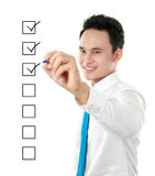 Check list. Businessman marking check boxes with marker Royalty Free Stock Photo