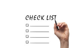 Check List. Hand with a pen writing check list Stock Photo