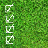 Check list over blur green grass Stock Photos