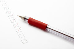 Check list with red ballpoint pen Royalty Free Stock Photo