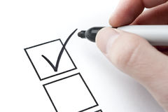 Check Mark and Box with Hand Writing Stock Photos