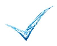Check mark made of splashes Royalty Free Stock Photos