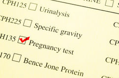 Check mark Medical form request Pregnancy test. Check mark Medical form request Pregnancy test in laboratory royalty free stock image