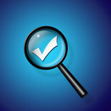 Check Mark under magnify glass Stock Photo