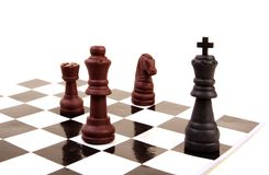 Check Mate. King in check by queen rook and knight Royalty Free Stock Photos