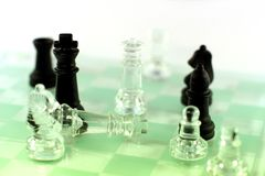 Check mate. Chess game in front of white background, check mate of white king Royalty Free Stock Image