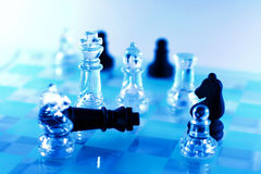 Check mate of black king. On a blue spotlighted chess game Stock Image