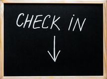 Check in message and arrow pointing downwards Royalty Free Stock Photography