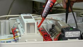 Check microcontroller control element contacts voltage indicator in factory. stock footage