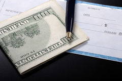 Check and money Royalty Free Stock Image