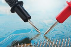 Check by multimeter, electronic circuit board of digital device with components. Troubleshooting in the electronic device. Check by multimeter, electronic stock images