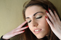 Check my lids. Female model with her eyes closed and both hands up by her face Royalty Free Stock Photo