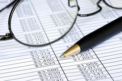 Check the numbers on the spreadsheet Stock Photo