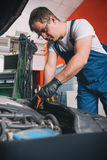 Check the oil level in engine Royalty Free Stock Photo