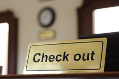 Check out. Close check out tablet  on reception desk Royalty Free Stock Images