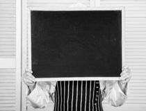 Check out cooking tips. Chef hold blackboard copy space hide face behind. Recipe concept. Cooking delicious meal step by. Step. Menu for today. List ingredients royalty free stock photos