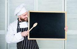 Check out cooking tips. Man chef hat apron hold blackboard copy space. Recipe concept. Cooking delicious meal step by. Step. Menu for today. List ingredients stock photo