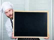 Check out cooking tips. Tips to cook like pro. Man chef hat apron hold blackboard copy space. Recipe concept. Cooking. Delicious meal step by step. Menu for royalty free stock photography
