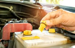 Check out the distilled car battery. Daily car check,Check out the distilled car battery Royalty Free Stock Image