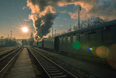 Check out the historic steam train on tracks. Historic steam train departs from the station Stock Photography