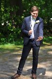 Check This Out. I´m Married!. The groom looks happily at his left hand where the ring is placed as he holds a glass of champagne in his other hand Royalty Free Stock Photography