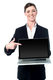 Check out the latest laptop in the market ! Stock Image